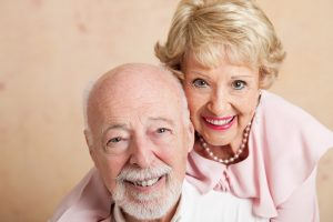 Smiling couple with dentures
