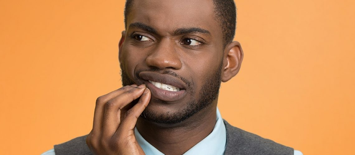 Man with mouth pain due to gum disease