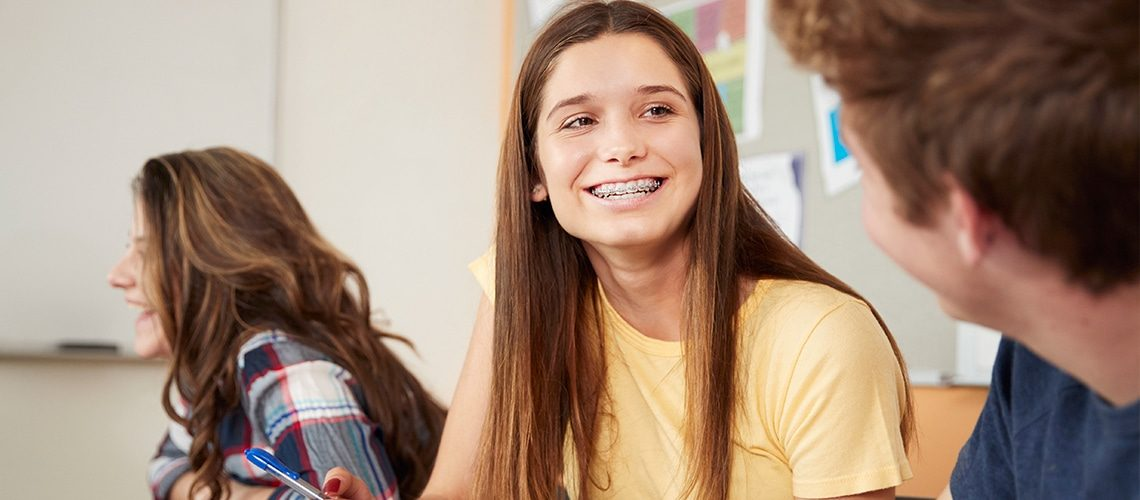 Teenager with braces smiling