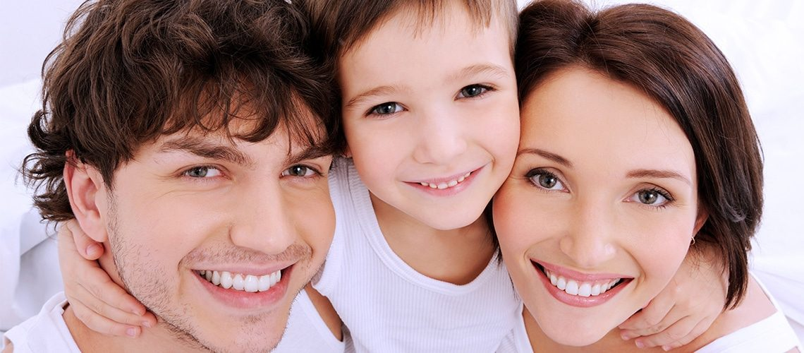 Male, Child and Female smiling