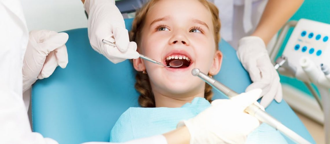 Female child in the dentist chair