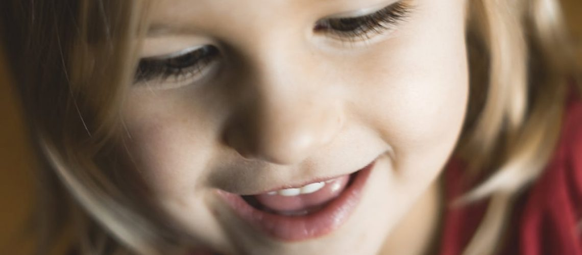 Smiling girl with chalky teeth