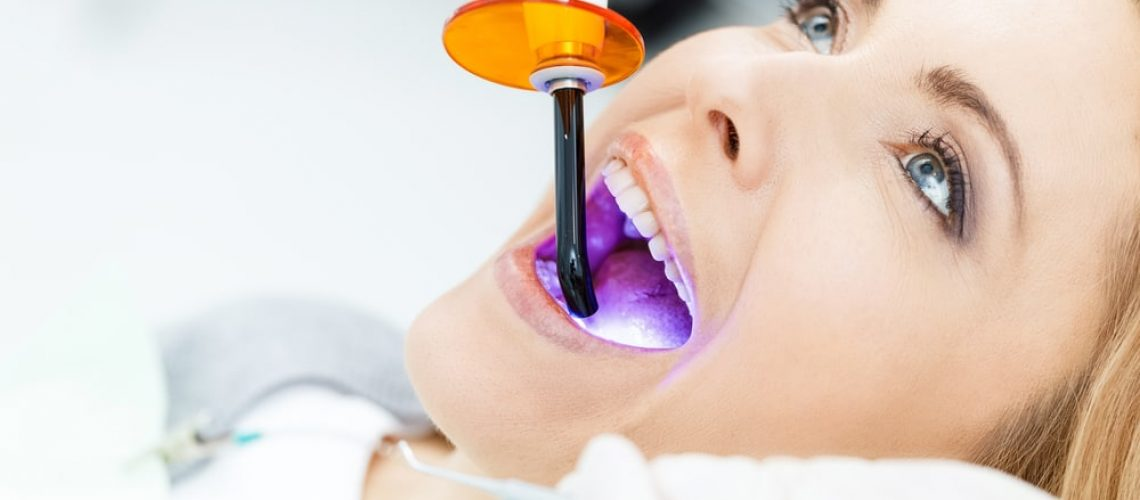 Female patient getting teeth whitened
